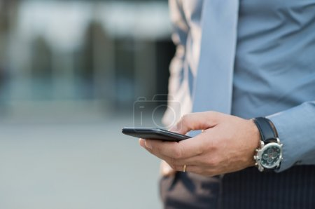 Businessman Holding Smartphone