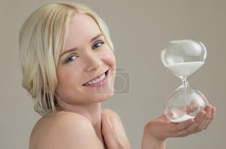 Woman holding hour glass