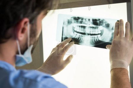 Doctor with dental x-ray