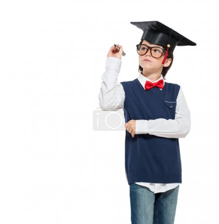 Photo for Graduated little boy wearing mortarboard and holding pen isolated on white background. - Royalty Free Image