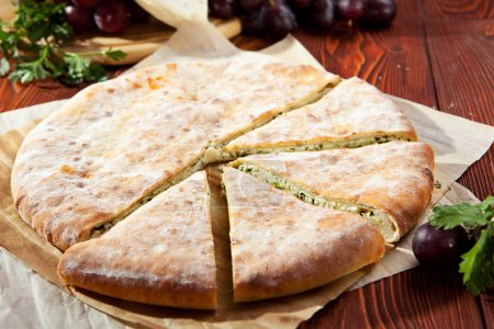 Photo for Ossetian Pie with Cheese and Herbs - Royalty Free Image