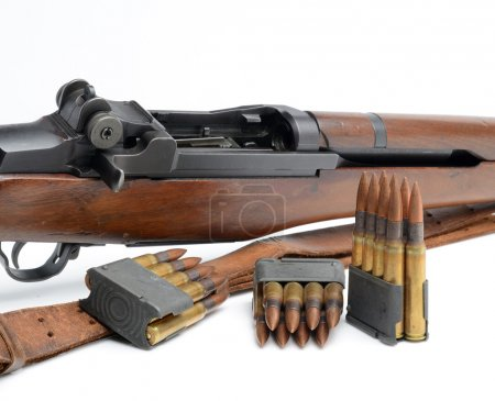 M1 Garand Rifle, clips and ammunition on white background.