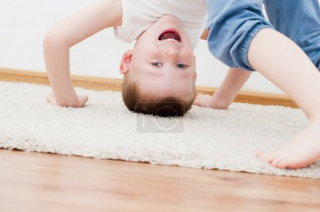 Kid standing upside down