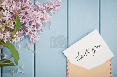 Photo for Vintage postage envelope with card thank you and beautiful summer blooming bouquet of lilac - Royalty Free Image