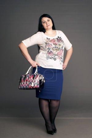 corpulent brunette with a ladies' handbag