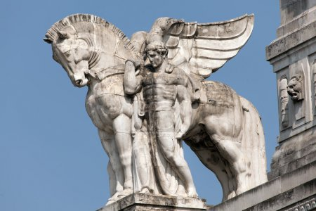 Statue of a man holding a winged horse on the Milan's main railway station