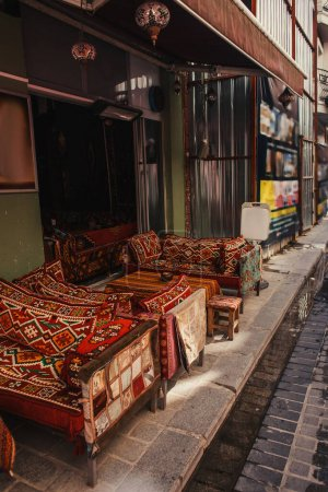 Sofas with traditional ornaments in outdoors cafe in Istanbul, Turkey