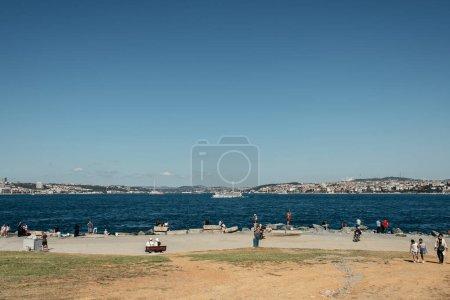 ISTANBUL, TURKEY - NOVEMBER 12, 2020: People walking on sea coast near water at daytime
