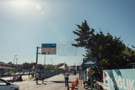 ISTANBUL, TURKEY - NOVEMBER 12, 2020: Signboard with lettering near road on urban street