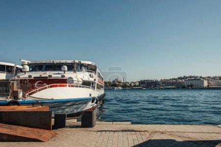 Turkish flag on ship near coast in Istanbul, Turkey