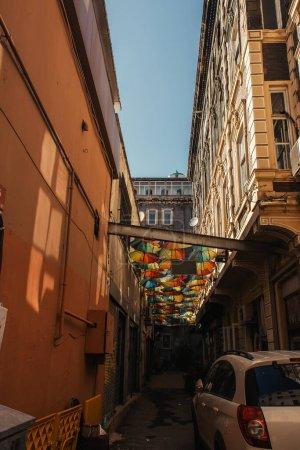 Umbrellas between buildings on urban street in Istanbul, Turkey