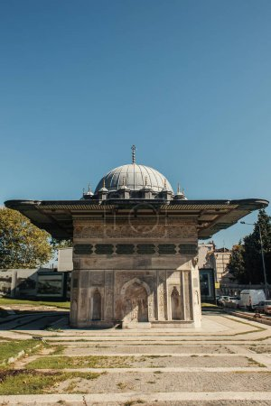 Facade of famous fatih Mosque near road in Istanbul, Turkey