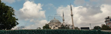 Photo for Clouds above Mihrimah Sultan Mosque in Istanbul, Turkey, banner - Royalty Free Image
