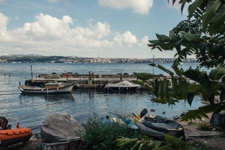Moored boats near pier in sea of Istanbul, Turkey