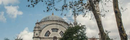 Low angle view of islamic Mosque of Mihrimah Sultan in Istanbul, Turkey, banner