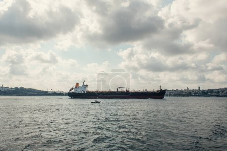 Photo for Cargo ship in sea with cloudy sky at background, Istanbul, Turkey - Royalty Free Image