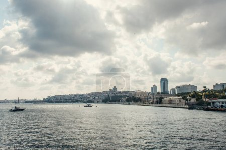Ships in sea near seafront with cloudy sky at background, Istanbul, Turkey