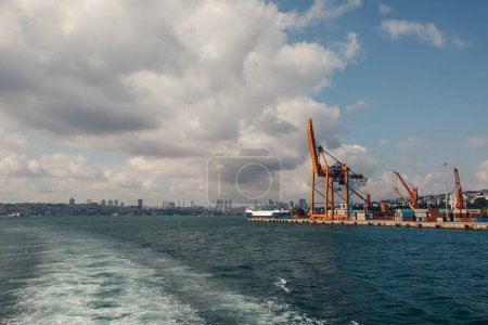 Photo for Cargo cranes and ship in port of Istanbul, Turkey - Royalty Free Image