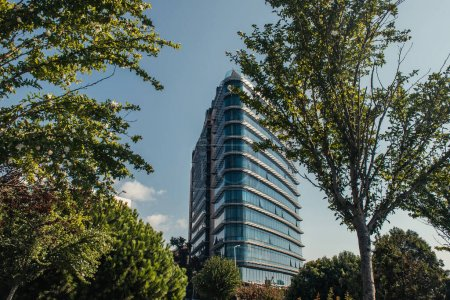 Building with glass facade near trees on street in Istanbul, Turkey