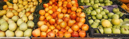 Ripe apples and pears on stall on street, banner