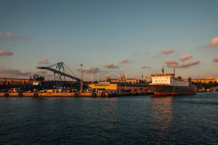 Photo for Cargo ship moored near port during sunset, Istanbul, Turkey - Royalty Free Image