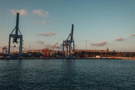 Photo for Constructions and cranes in cargo port near sea in Istanbul, Turkey - Royalty Free Image