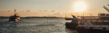 Ships in sea with sunset sky at background in Istanbul, Turkey, banner