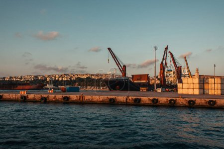 Photo for Heavy machinery in sea port of Istanbul during sunset, Turkey - Royalty Free Image