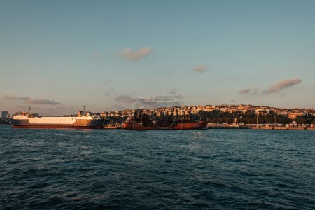 Ships near seafront and Istanbul city during sunset, Turkey