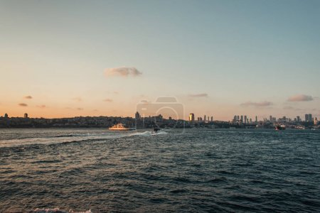 Photo for Yacht in sea with coast and sunset sky at background, Istanbul, Turkey - Royalty Free Image