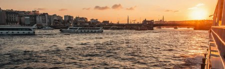 Ships floating on sea water near Istanbul city during sunset, Turkey, banner
