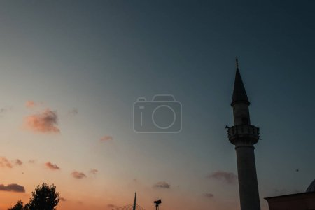 Low angle view of column of Mihrimah Sultan Mosque and sky during sunset at background, Istanbul, Turkey