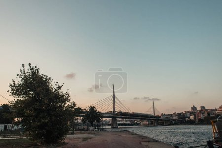 View of Golden horn metro bridge and sea during sunset in Istanbul, Turkey