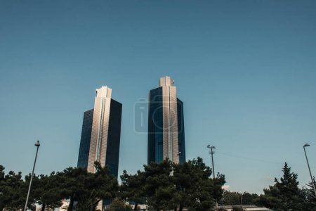 two modern multistorey buildings against clear sky in Istanbul, Turkey