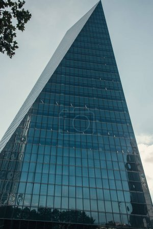 low angle view of hi-tech skyscraper with glass facade in Istanbul, Turkey
