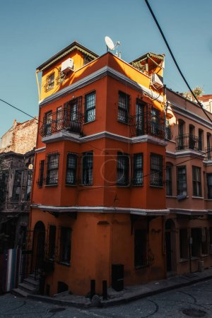 red, authentic building with fenced windows and balconies in Balat quarter, Istanbul, Turkey