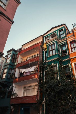 old buildings with green ivy and laundry on balconies in Jewish quarter, Istanbul, Turkey