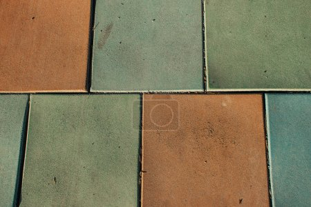 background with brown and grey ceramic tiles, top view