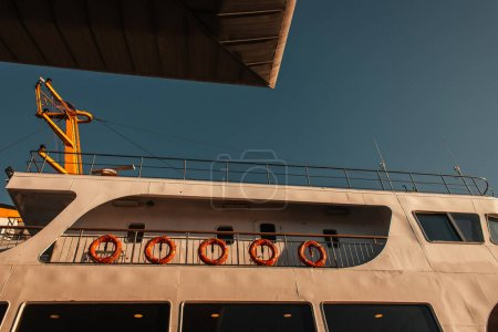 Photo for Red lifebuoys on moored vessel against blue sky, Istanbul, Turkey - Royalty Free Image