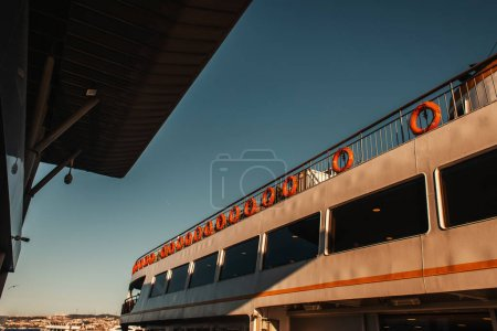 Photo for Red lifebuoys on moored ship in Istanbul, Turkey - Royalty Free Image