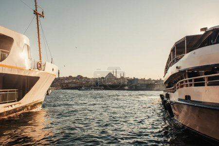 moored ships and view of city from Bosphorus strait, Istanbul, Turkey