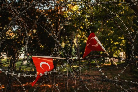 turkish flags in barbed wire fence in park of Istanbul, Turkey