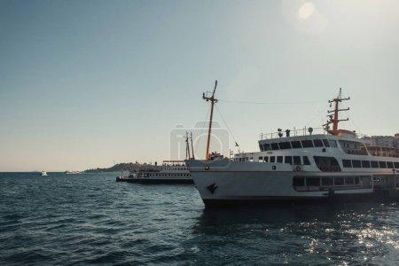 blue, cloudless sky over vessels floating on Bosphorus strait