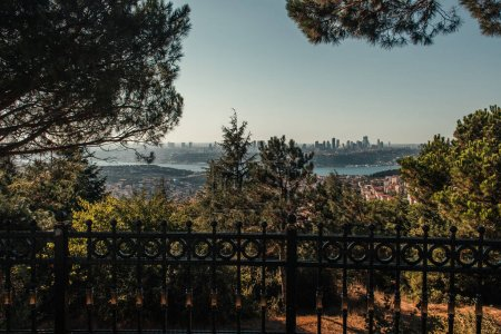 fence, green trees, and city view with Bosphorus strait