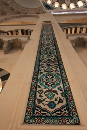 ISTANBUL, TURKEY - NOVEMBER 12, 2020: low angle view of column with ornamental tiles in Mihrimah Sultan Mosque