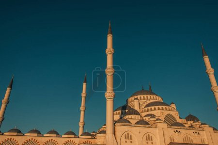 blue, cloudless sky over Mihrimah Sultan Mosque with high minarets, Istanbul, Turkey