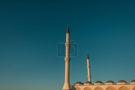 blue, cloudless sky over high minarets of Mihrimah Sultan Mosque, Istanbul, Turkey