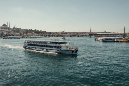 view of city from Bosphorus strait with floating and moored ships, Istanbul, Turkey