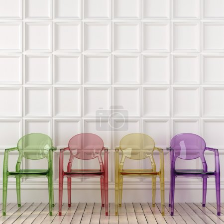 Colored transparent chairs and white wall