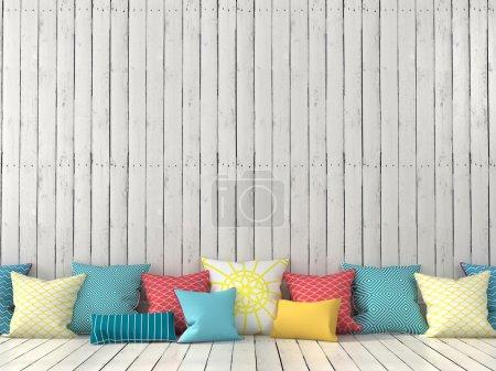 Photo pour Coussins colorés sur le fond d'un mur avec des tableaux blancs - image libre de droit